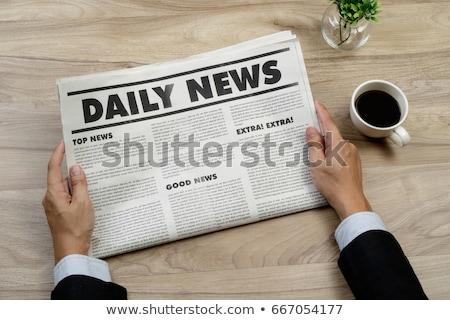 Férfi olvas újság fából készült asztal üzletember Stock fotó © AndreyPopov