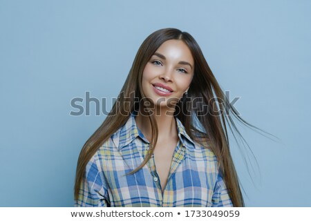 photo of gorgeous woman with long dark hair and healthy skin cle stock photo © deandrobot
