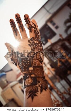 woman with mahendi hand decorated with henna tattoo mehendi hand stockfoto © galitskaya