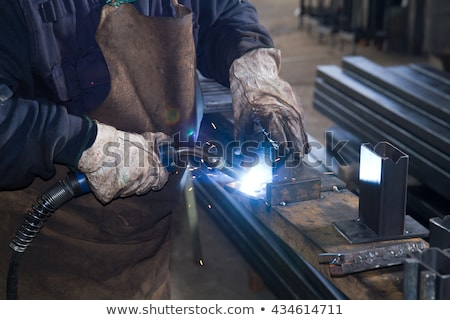 Welder in his workshop welding metal Сток-фото © Kzenon