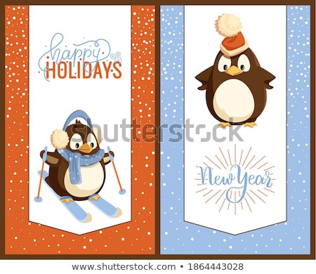 Penguin in Santa Hat and Earmuffs on Skis Card Stock photo © robuart