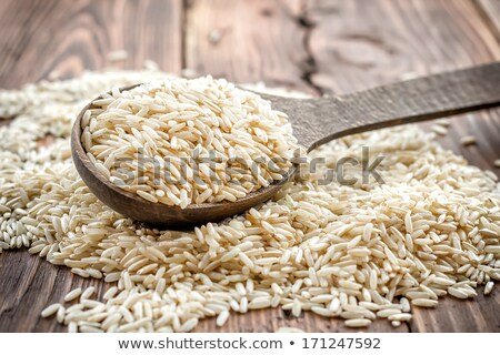 Wooden spoon of raw organic basmati long grain and wild rice on white background. Healthy food.  Stock photo © DenisMArt
