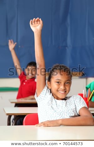 Two smiling young school children arms raised in class Stock photo © sgursozlu