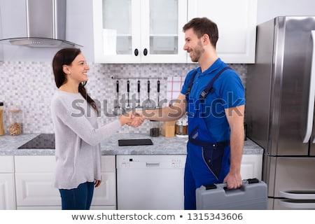 Boldog fiatal technikus munkaruha kezet fog háziasszony Stock fotó © pressmaster