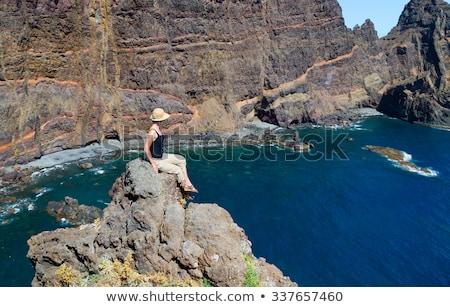 женщины сидят океана орел рок Сток-фото © lovleah