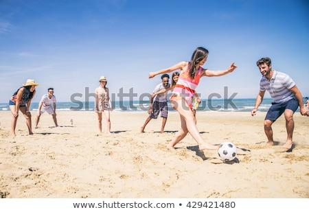 pelota · juego · playa · hombre · mujer · jugando - foto stock © lopolo