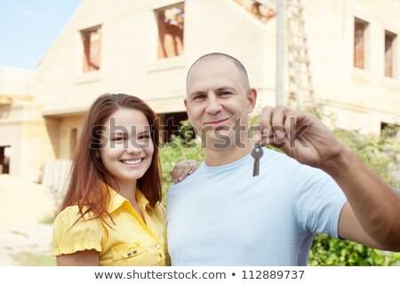 Couple  Holding key in front of street Stock photo © wavebreak_media