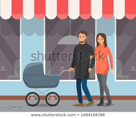 Couple with Baby Carriage Walk by Cafe Windows Stock photo © robuart