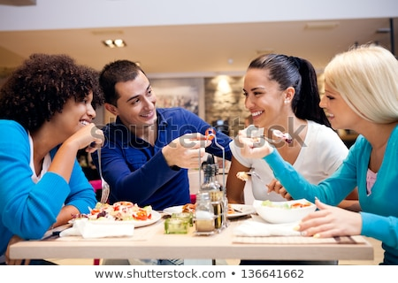 Young woman enjoying lunch in lounge restaurant Stock photo © dash