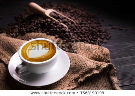 View at hot coffee latte with heart shape foam Stock photo © boggy