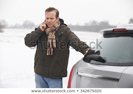 Motorist Broken Down In Snowy Landscape Stock photo © HighwayStarz