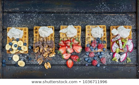Belgium waffles with strawberries and banana Stock photo © furmanphoto