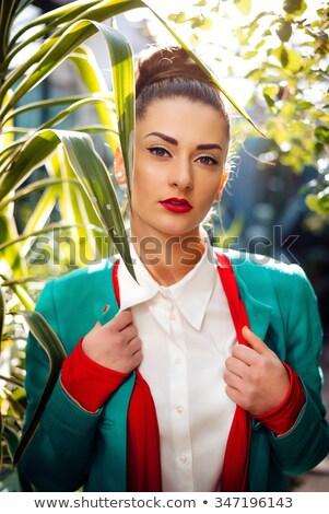 Hermosa mujer brillante azul abrigo Foto stock © ElenaBatkova