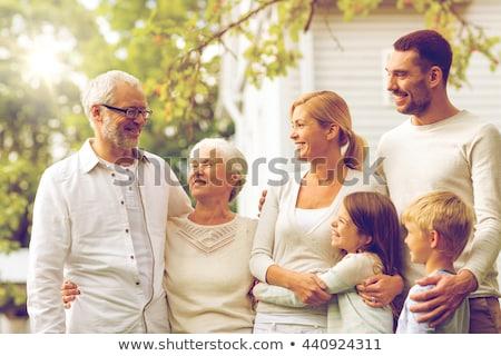 Genç mutlu aile üç durmak birlikte açık havada Stok fotoğraf © vkstudio
