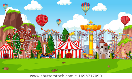 Themepark scene with many rides in the field Stock photo © bluering