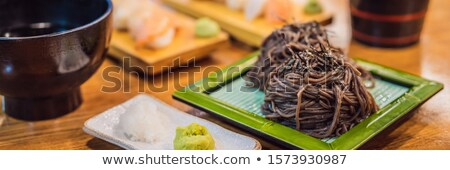 Korean buckwheat lamb served on a bamboo mat BANNER, LONG FORMAT Stock photo © galitskaya