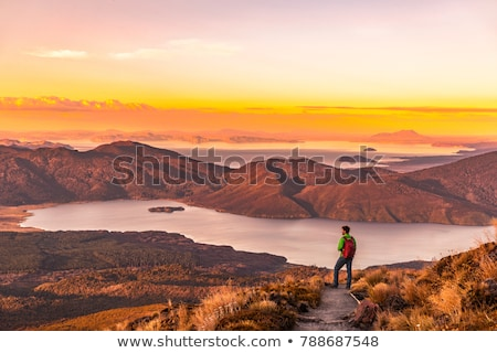 Travel adventure in New Zealand. Tourist explorer backpacking in nature landscape by Franz Josef Gla Stock photo © Maridav
