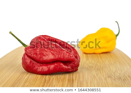 Little red peppers with two yellow on a white Stock photo © lypnyk2