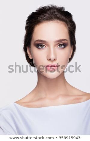 Karcsú fiatal barna hajú nő pózol portré Stock fotó © lithian