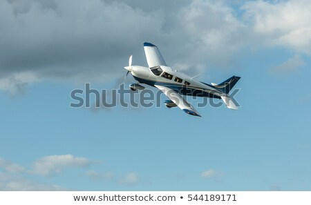 Airplane Flying in a Blue Sky over Green Grass Stock photo © mikdam