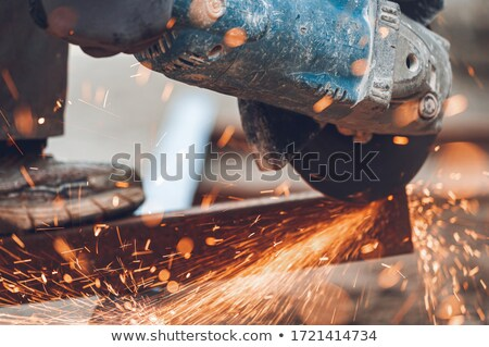 Construction worker using a technical tool Stock photo © photography33