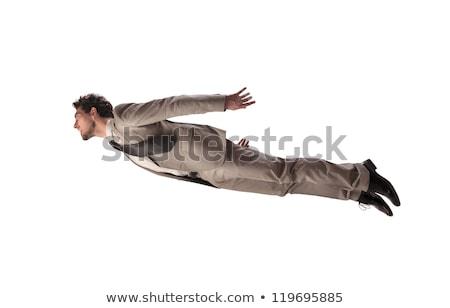 happy flying businessman stock photo © smithore