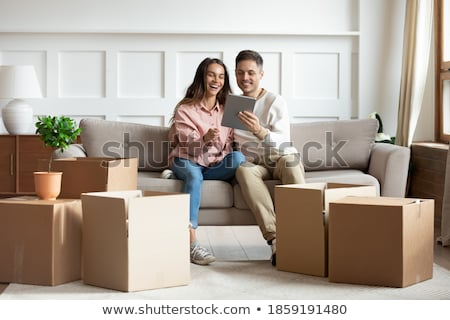 Woman repairing computer and man sitting on a sofa Stock photo © photography33