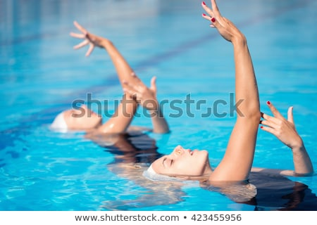 synchronized swimming Stock photo © abdulsatarid