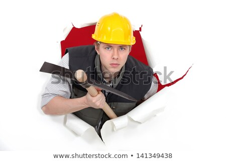 man with pick axe tearing through poster stock photo © photography33