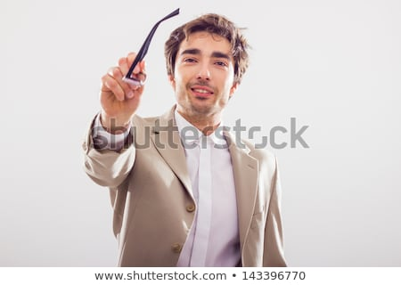 A businessman handing his glasses over. Stock photo © photography33