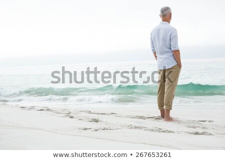 a mature man looking at the ocean stock photo © photography33