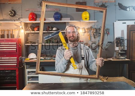 Carpenter posing with a picture frame Stock photo © photography33