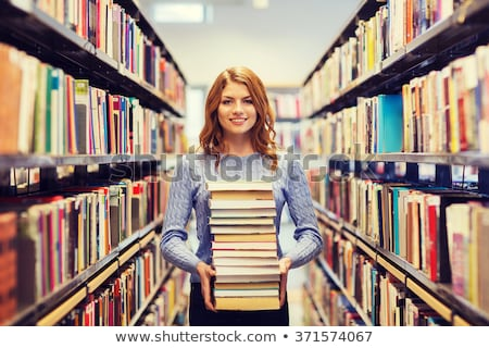 Beautiful woman with a stack of books Stock photo © photography33