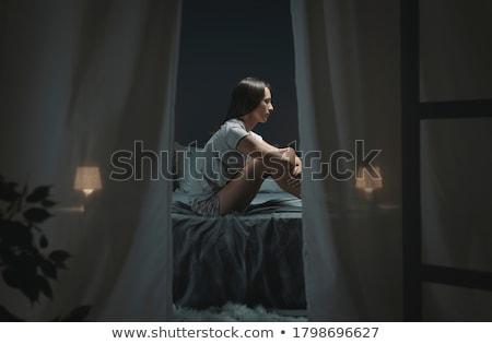 Kadın oturma yatak güzel genç kadın ev Stok fotoğraf © studiofi
