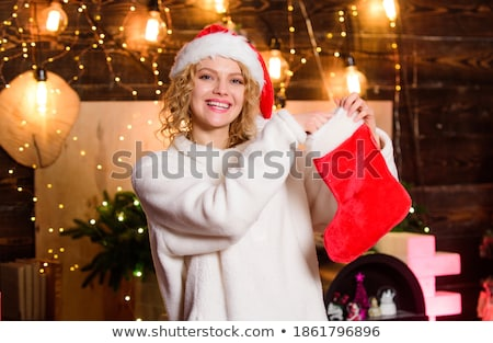 santa claus girl in red party stockings stock photo © carlodapino
