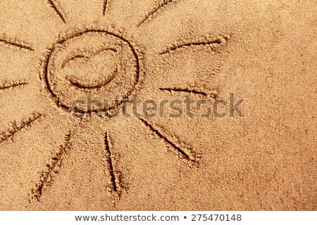 Uśmiechnięta twarz piasku piasek na plaży uśmiech twarz Zdjęcia stock © pzaxe