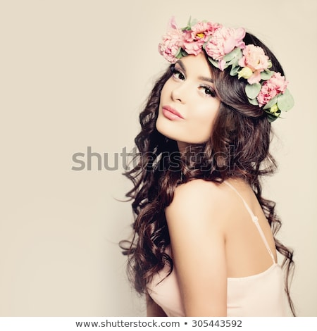Girl with wreath of flowers on head. Hair. Beautiful Brunette Gi Stock photo © Victoria_Andreas