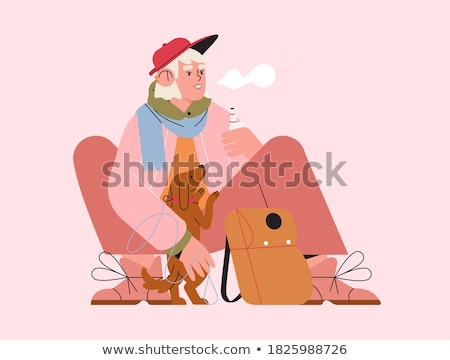 Young woman with dog and e-cigarette stock photo © Pasiphae