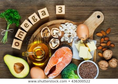 Omega 3 kezek elvesz omega3 gél kapszulák Stock fotó © Stocksnapper