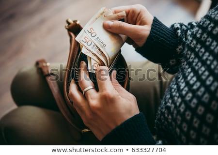 Oszczędności euro pieniężnych mały torebce jeden Zdjęcia stock © tainasohlman
