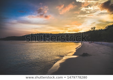 fishing boats at sunset in koh rong Cambodia Stock photo © travelphotography
