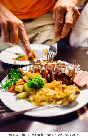 People eating roast pork in Bavarian restaurant Stock photo © Kzenon