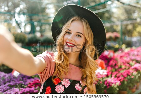 Pretty young lady in the botanical garden Stock photo © konradbak