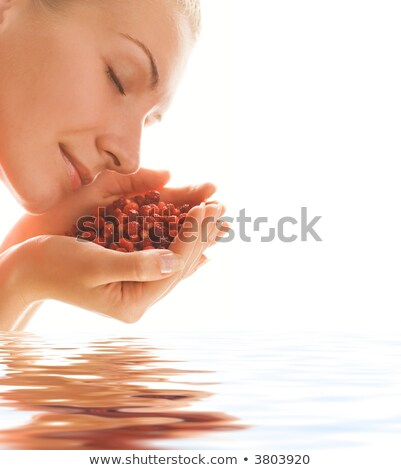 Handful of small red berries reflected in rendered water Stock photo © Nejron