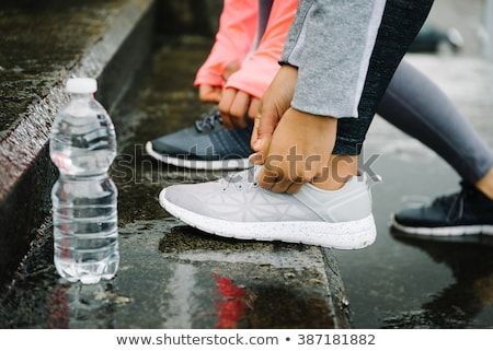 bottle in the rain stock photo © hofmeester