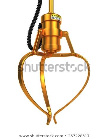 Closed Golden Robotic Claw. Stock photo © tashatuvango