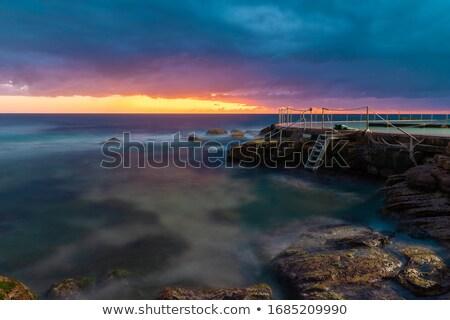 Plage aube sunrise urbaine lumières visible Photo stock © lovleah