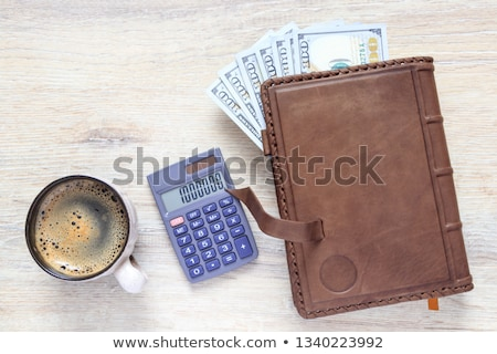 One coffee cup and US dollars Stock photo © CaptureLight