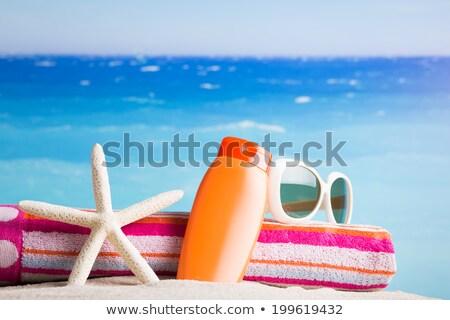 Opalenizna mleczko kosmetyczne butelek plaży słoneczny Zdjęcia stock © stevanovicigor