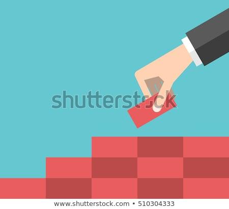 man is building diagram from red blocks stock photo © boroda